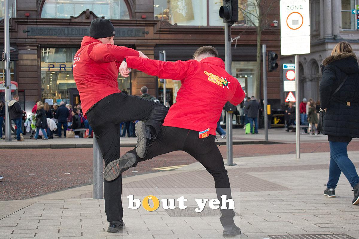 Fighting tourbus guys, Belfast. Photo 2704.