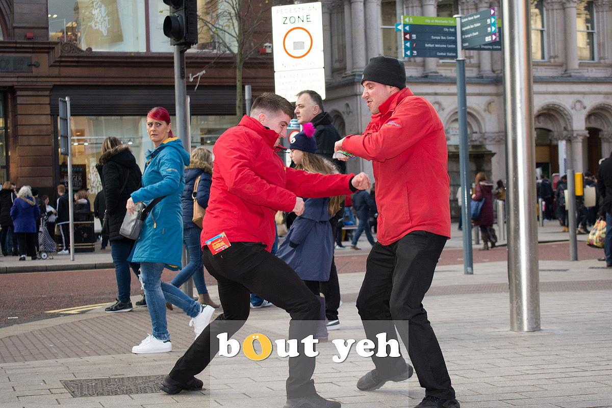 Fighting tourbus guys, Belfast. Photo 2706.