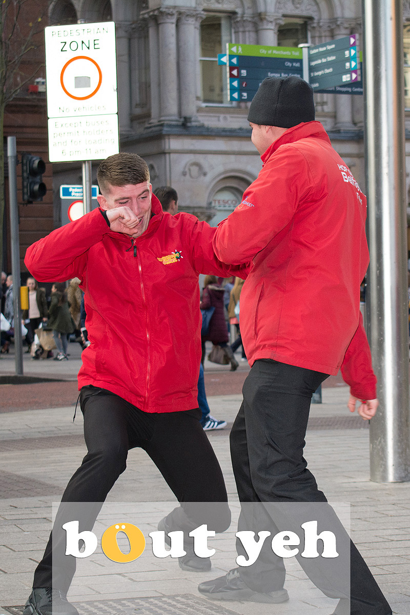 Fighting tourbus guys, Belfast. Photo 2707.