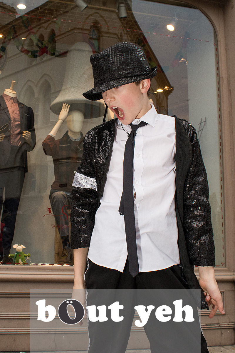 Young Michael Jackson impersonator entertains the crowd at Cornmarket Belfast. Photo 3207.