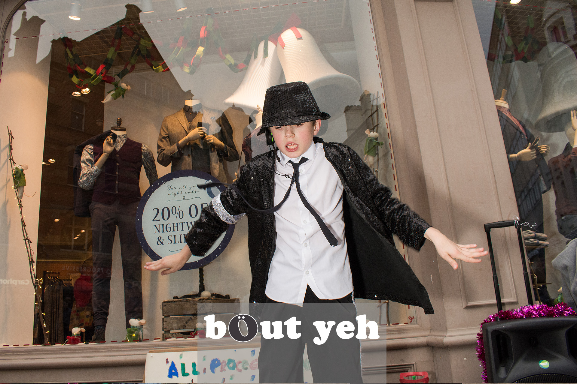 Young Michael Jackson impersonator entertains the crowd at Cornmarket Belfast. Photo 3220.