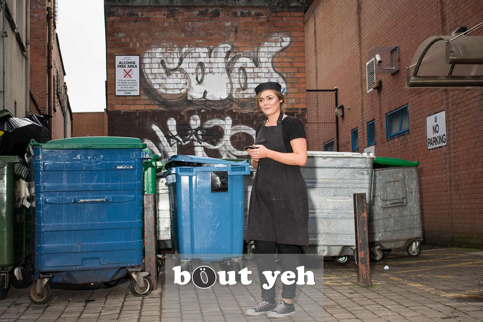 Beautician taking break outside, in Belfast city centre. Photo 3188.