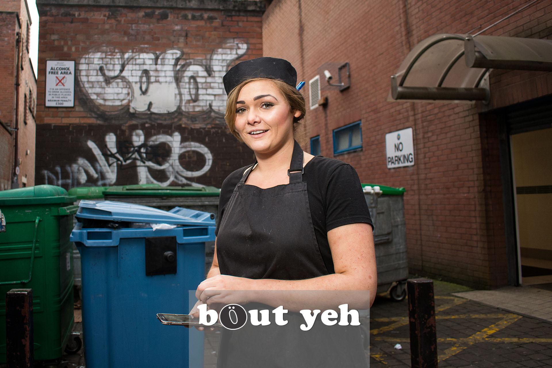 Beautician taking work break outside, in Belfast city centre. Photo 3191.