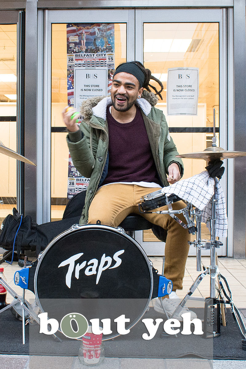 Busker from Brazil drumming in Belfast city centre. Photo 3242.