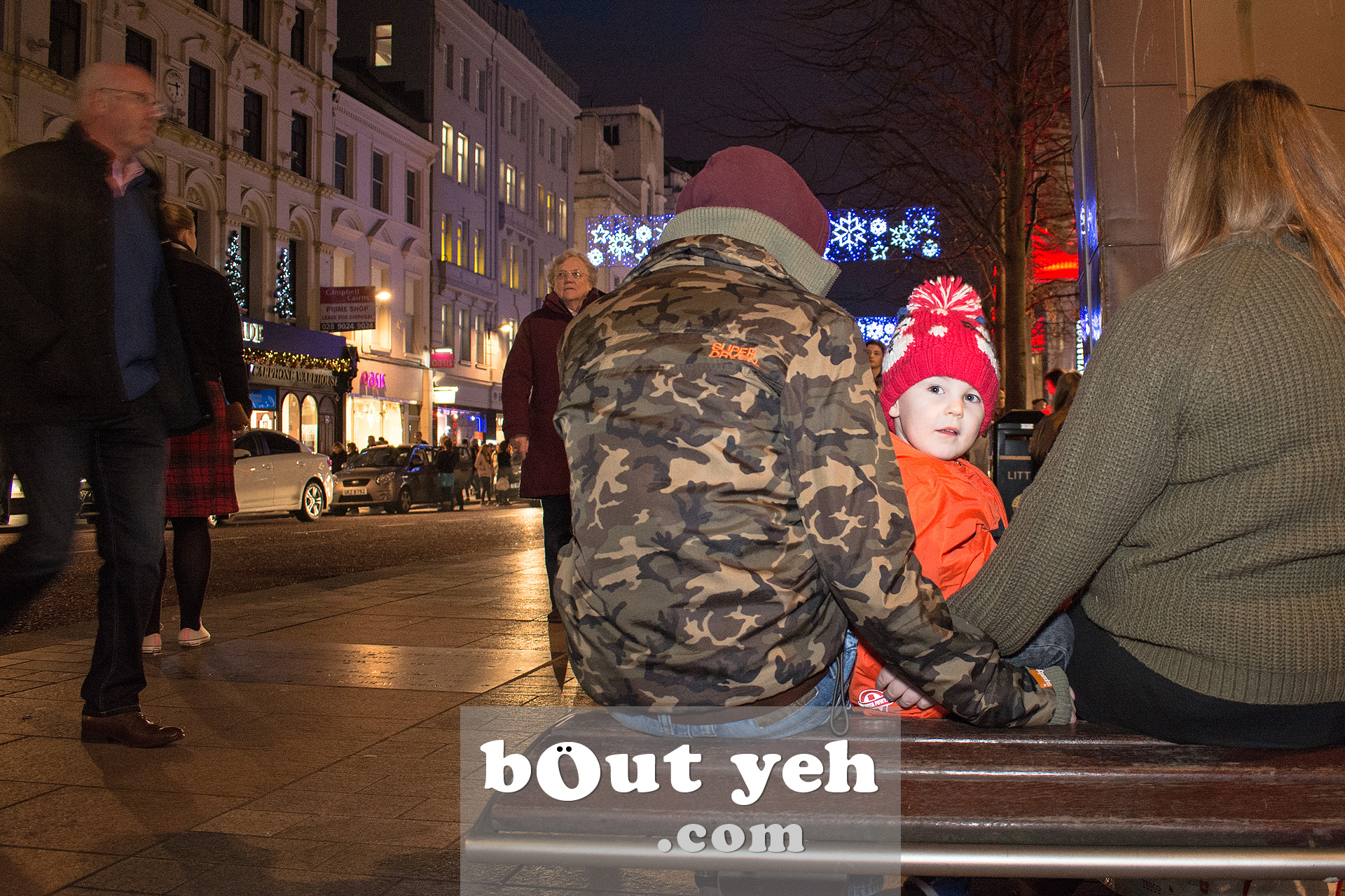 Young family waiting for the bus in Belfast city centre. Photo 3366.