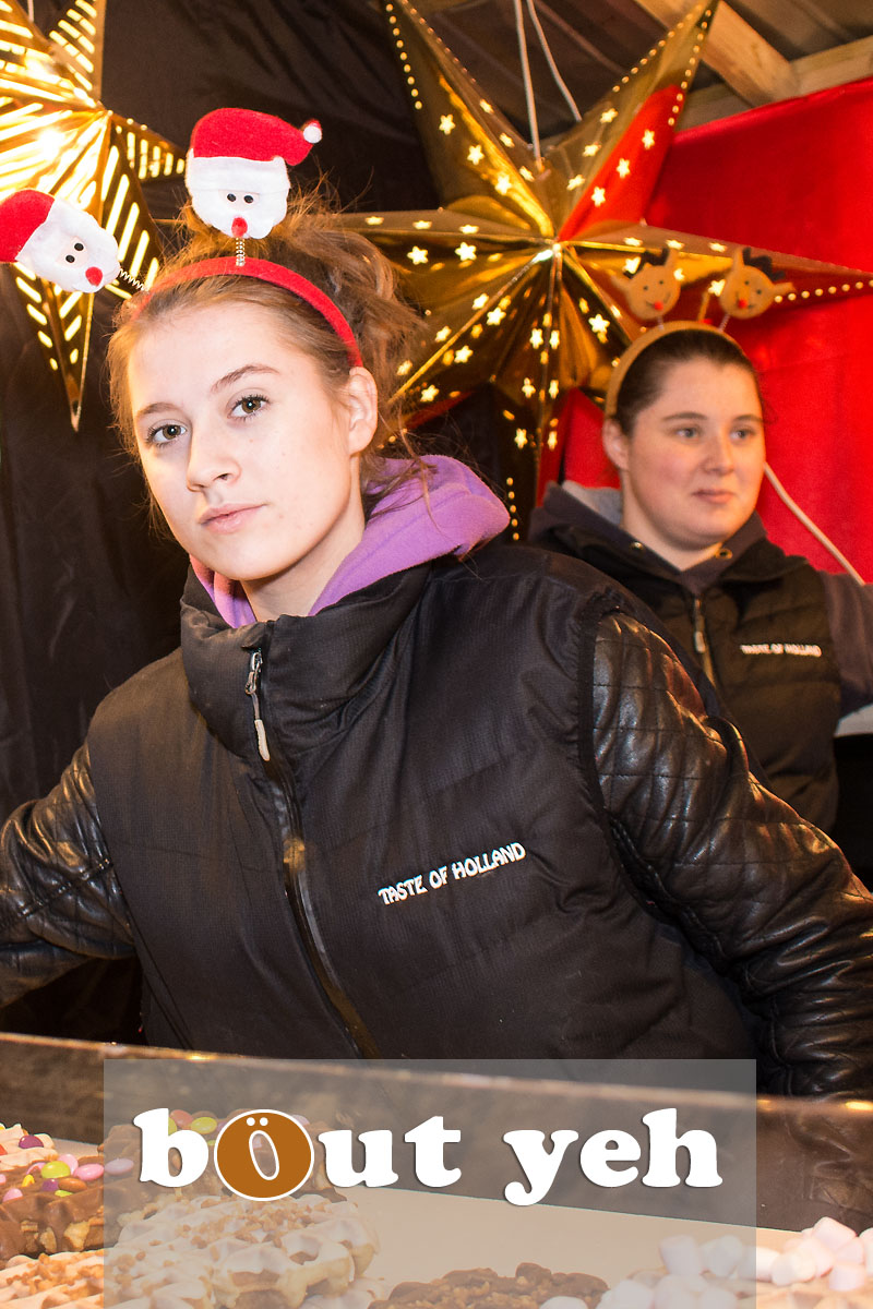 Two women at Belgian waffle stand, Belfast Continental Christmas Market, City Hall, Belfast, Northern Ireland - bout yeh photographers Belfast photo 3291.