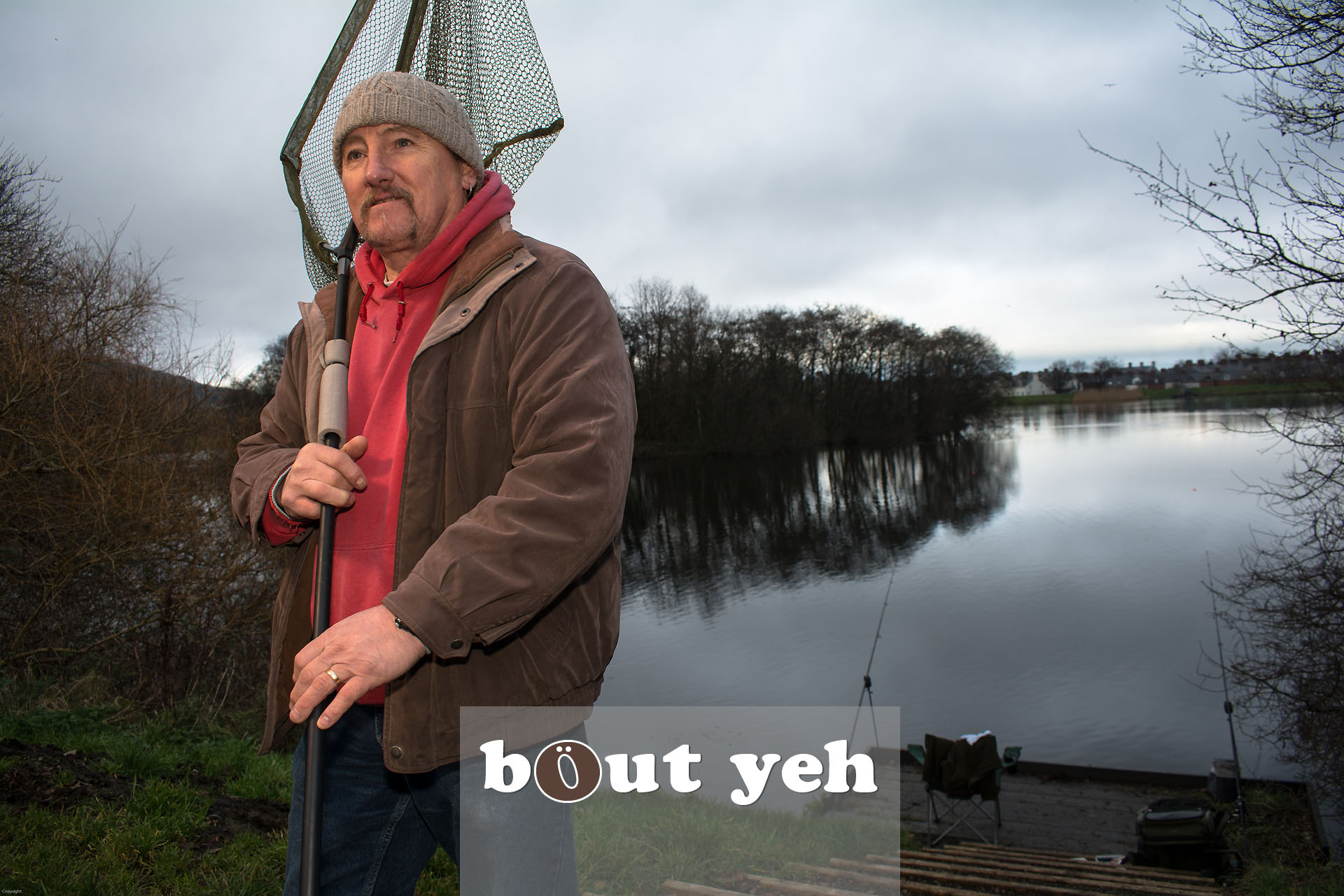 Man fishing for pike at Belfast Waterworks, Belfast Northern Ireland - bout yeh photographers Belfast photo 3936.
