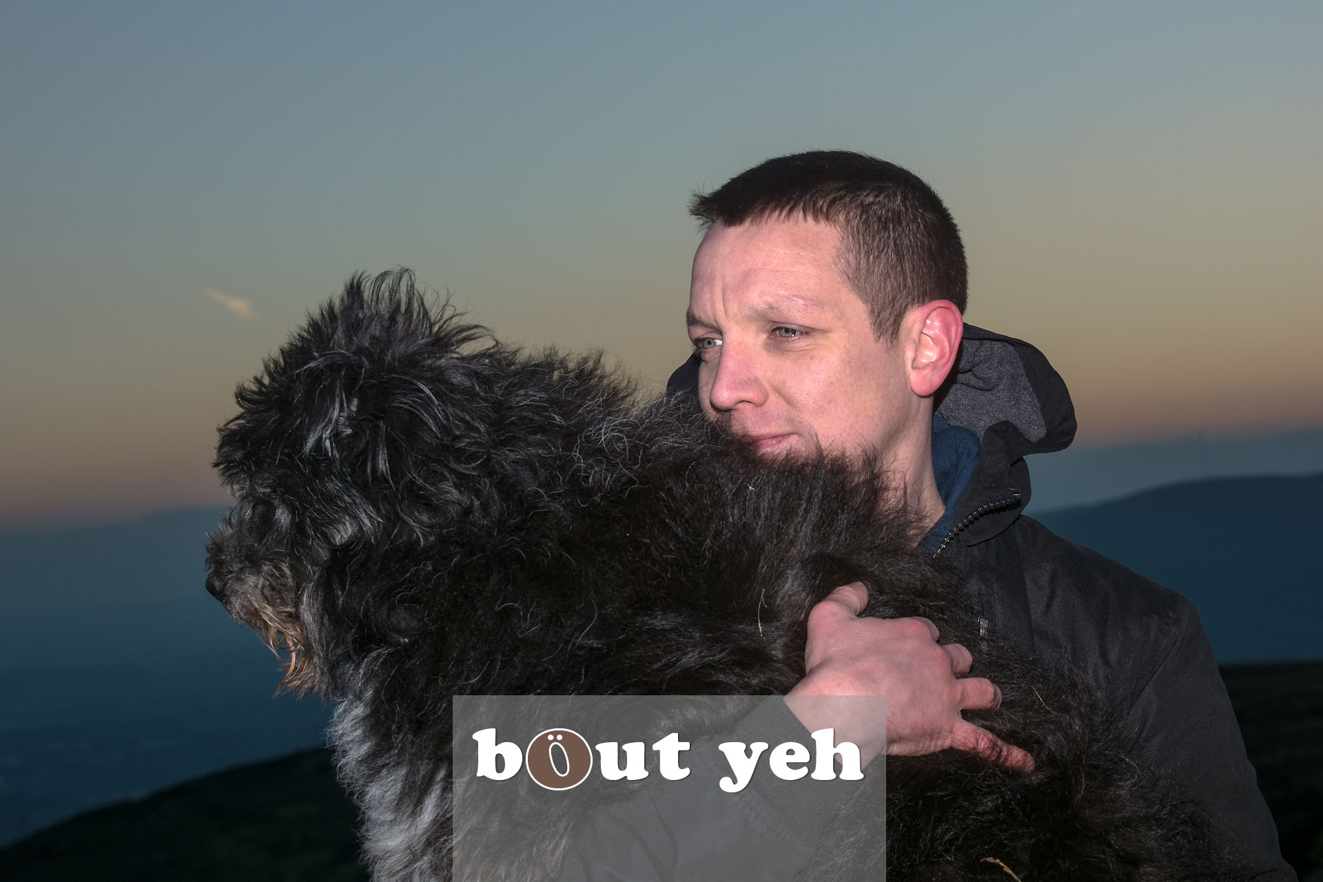 Man carries his dog for last walk on Cave Hill, Belfast, Northern Ireland - photo 4105.