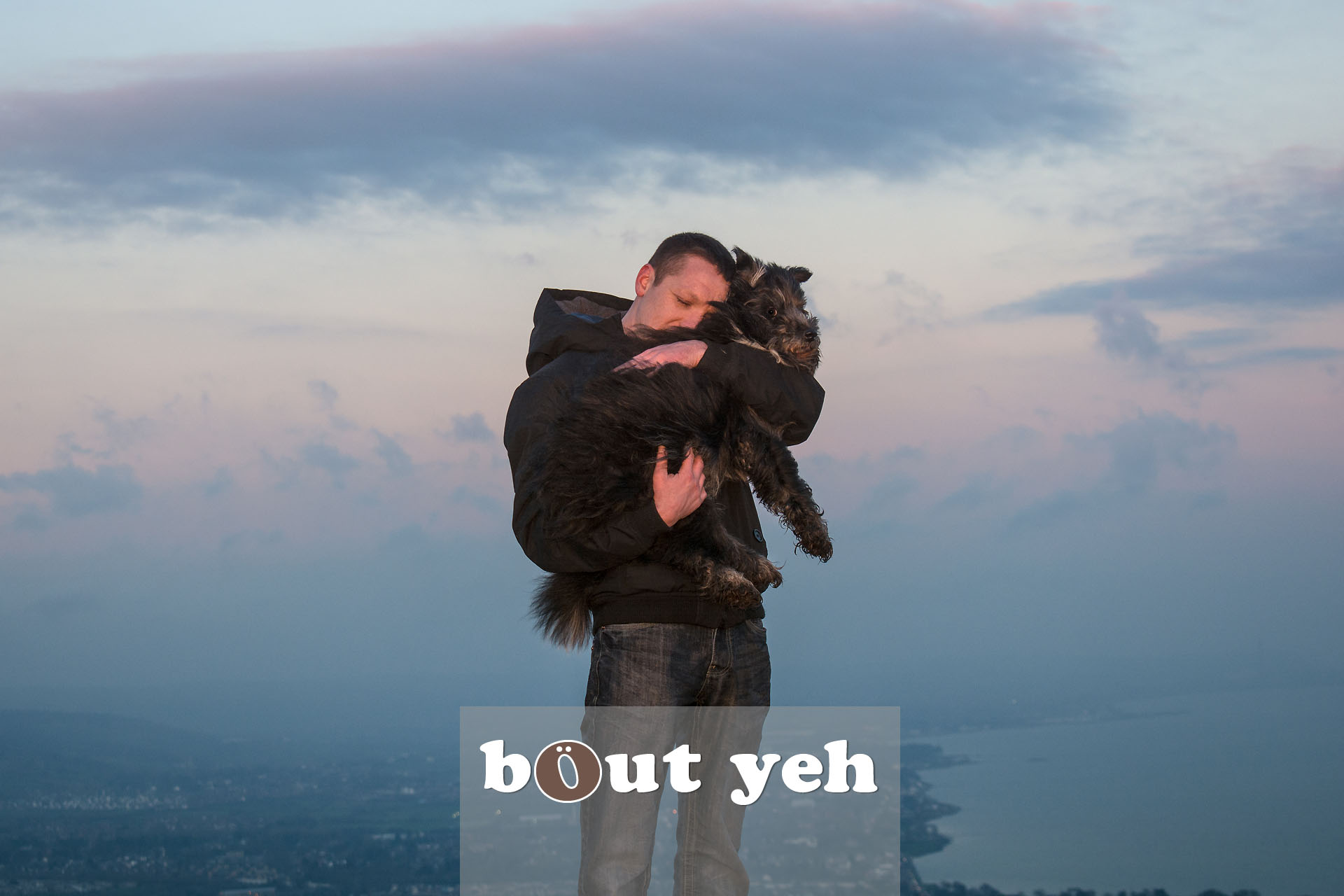 Man carries his dog for last walk on Cave Hill, Belfast, Northern Ireland. Photo 4111.