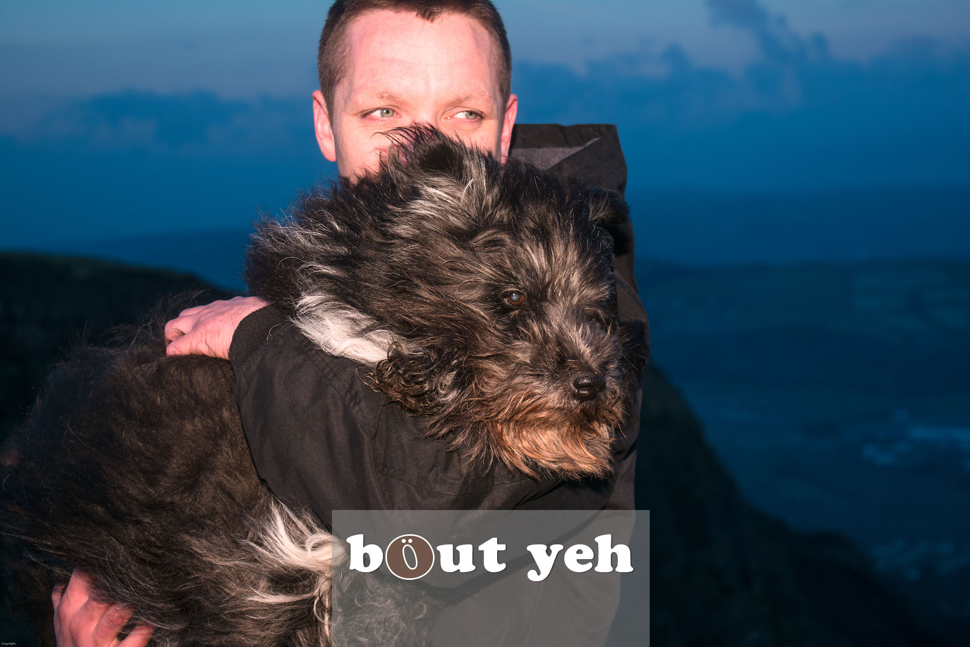 Man carries his dog for last walk on Cave Hill, Belfast, Northern Ireland - photo 4112.