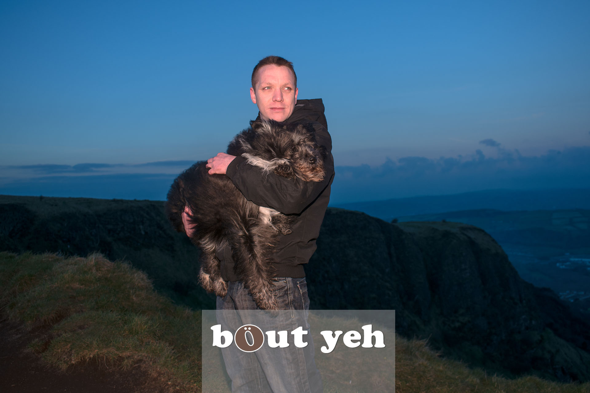 Man carries his dog for last walk on Cave Hill, Belfast, Northern Ireland - photo 4115.