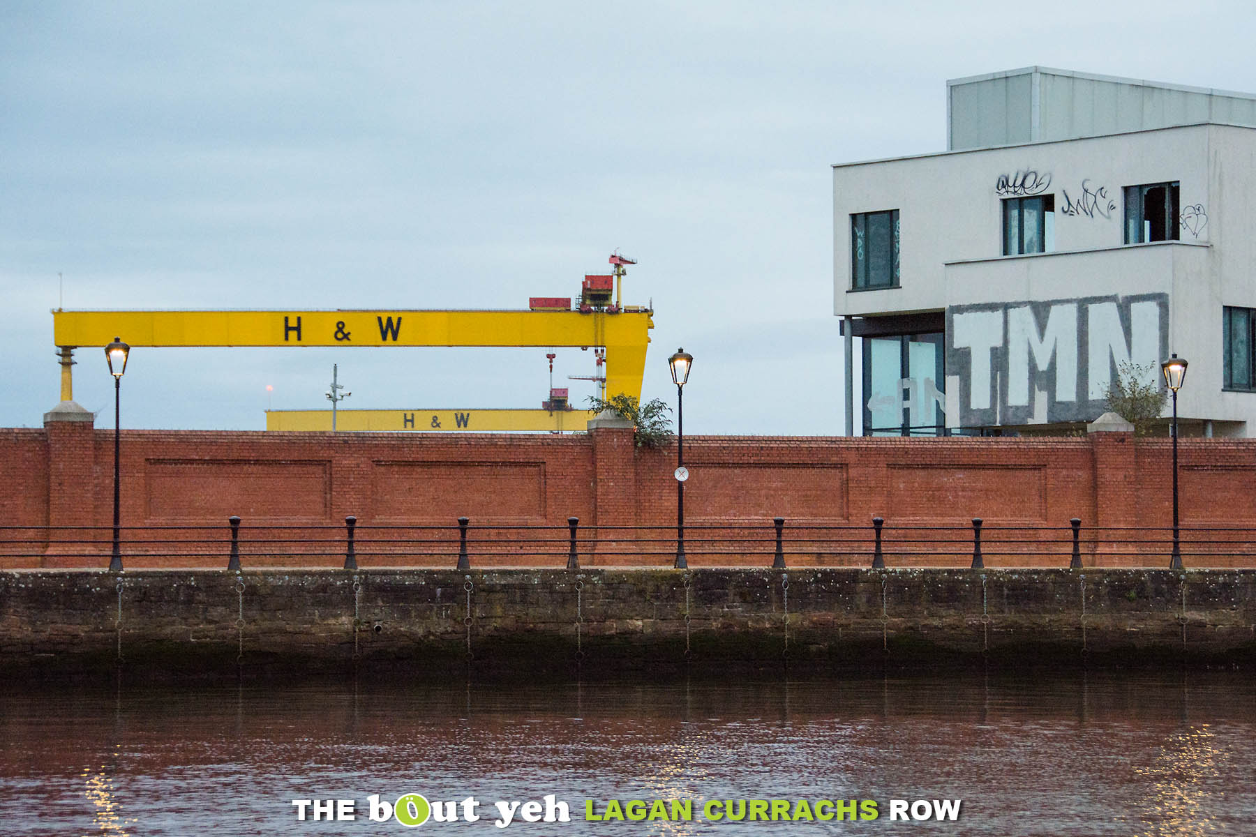 Harland and Wolff cranes and TMN graffiti photographed from the River Lagan, Belfast - photo 9250.