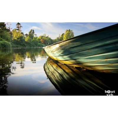 Rowing boat reflected in water - photographic print for sale. Photo by Glenda Hall.