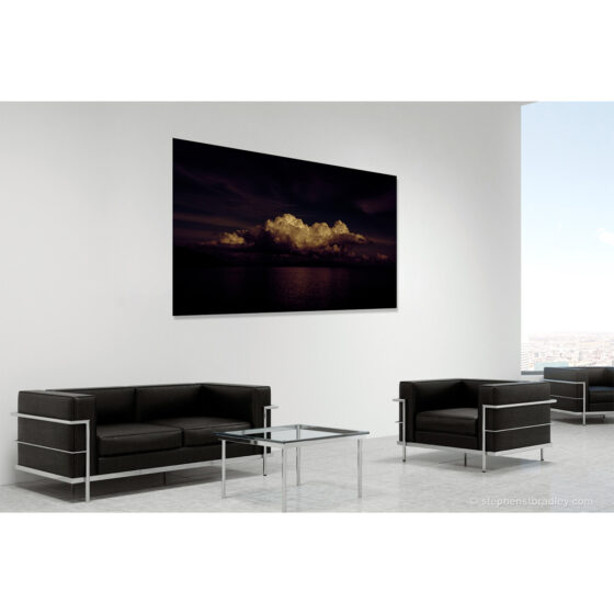 A Very Particular Place - limited edition photographic print in room setting of clouds over Cushendun Bay, Northern Ireland