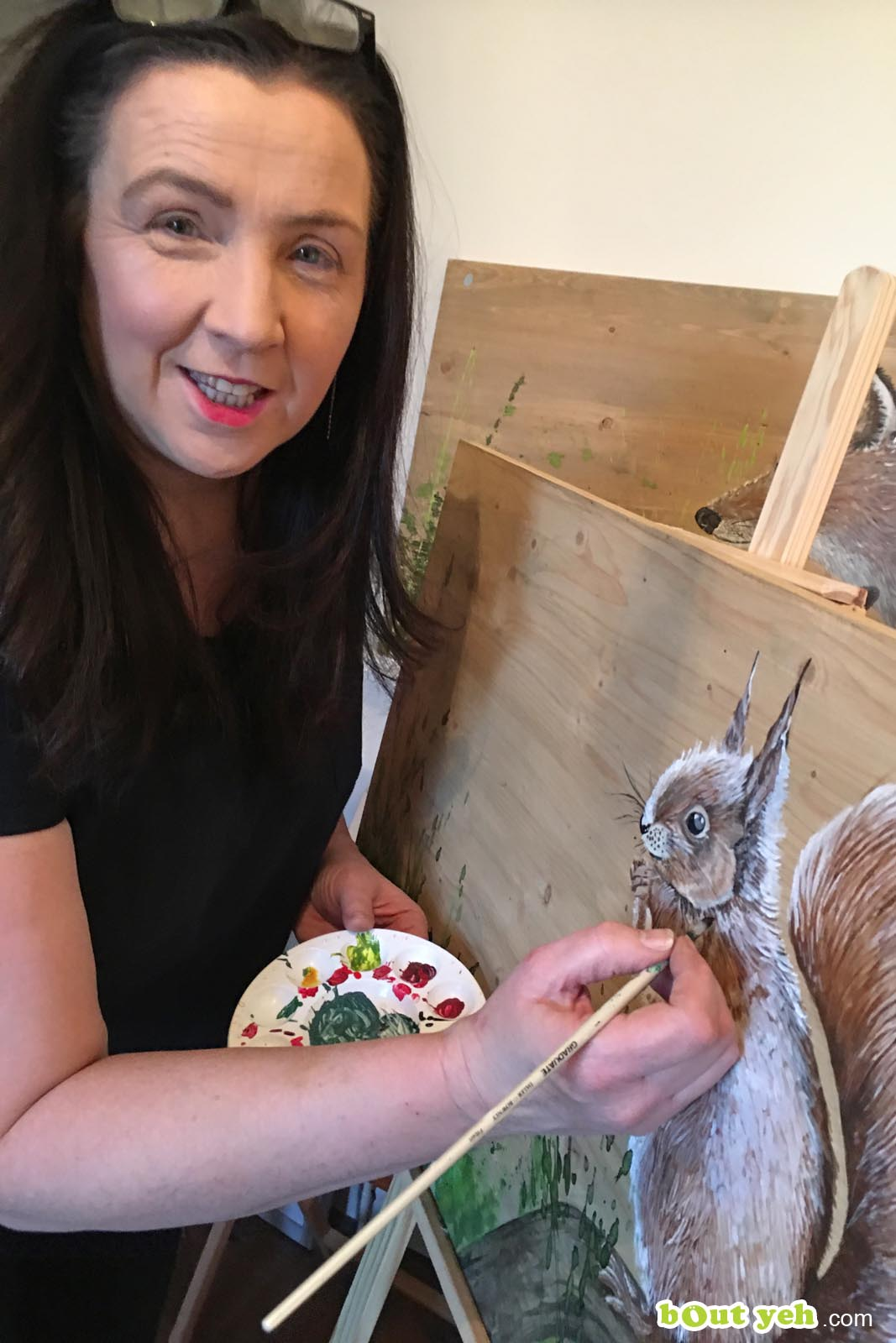 Sandra Shaw artist painting in her studio - photo shared by Bout Yeh photography and video production Belfast