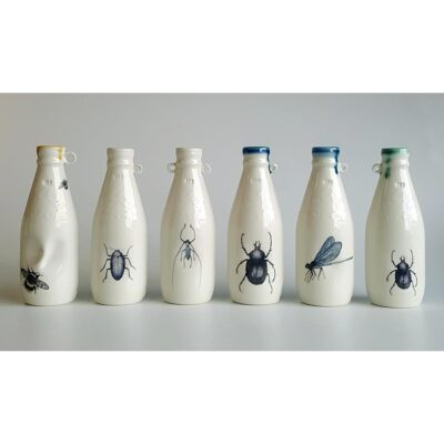 Ceramic typical Irish milk bottles with insect decals. Irish ceramics and porcelain for sale by Bout Yeh art and crafts gallery Belfast and Dublin, Ireland