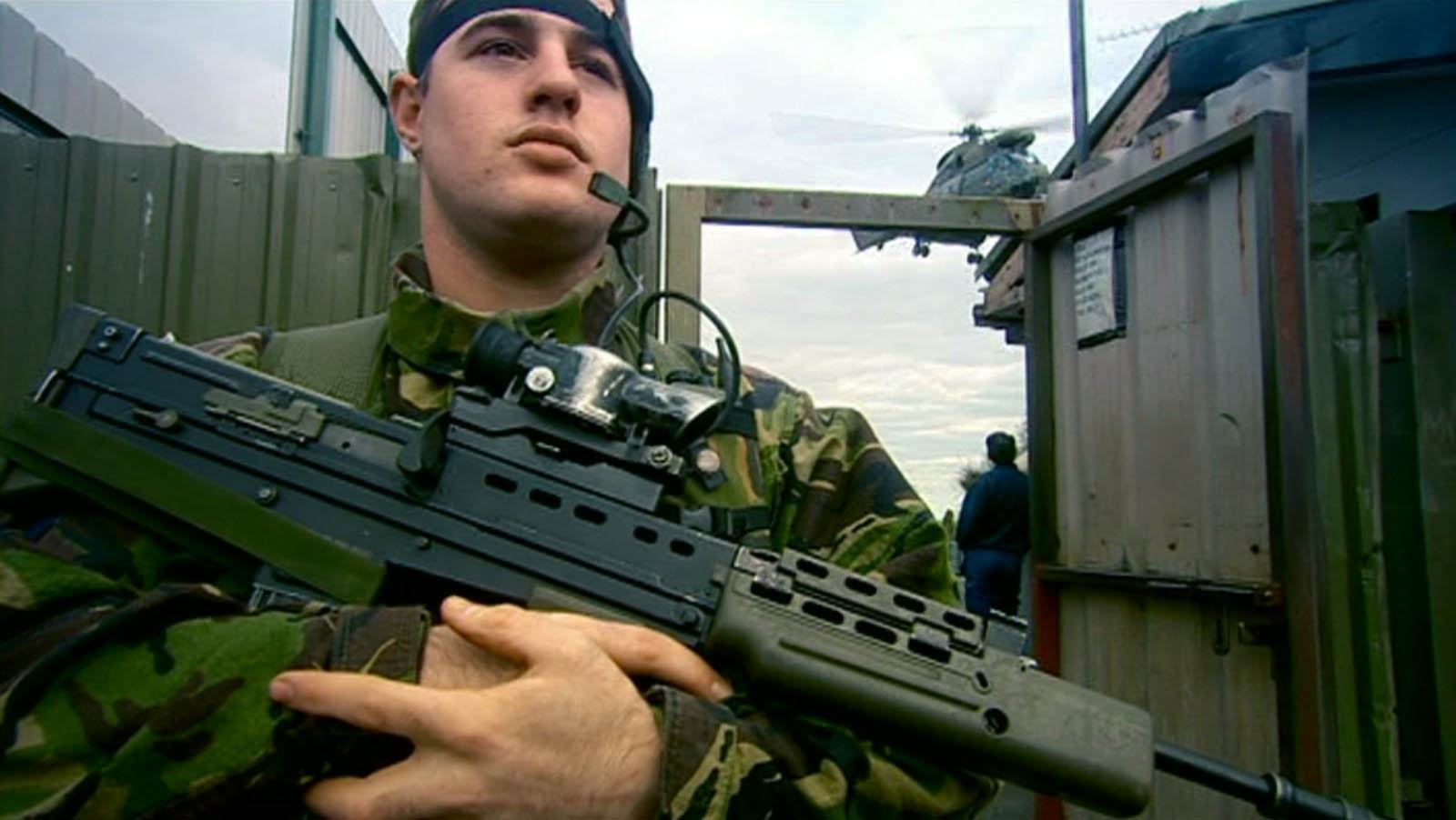 Video production for BBC Worldwide of Magnum photographer Donovan Wylie - soldier in front of British army helicopter filmed by a director at Bout Yeh video production Belfast, Northern Ireland