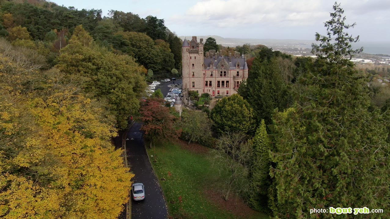 Aerial photo of car approaching Belfast Castle along a tree lined road - photo 1 291020