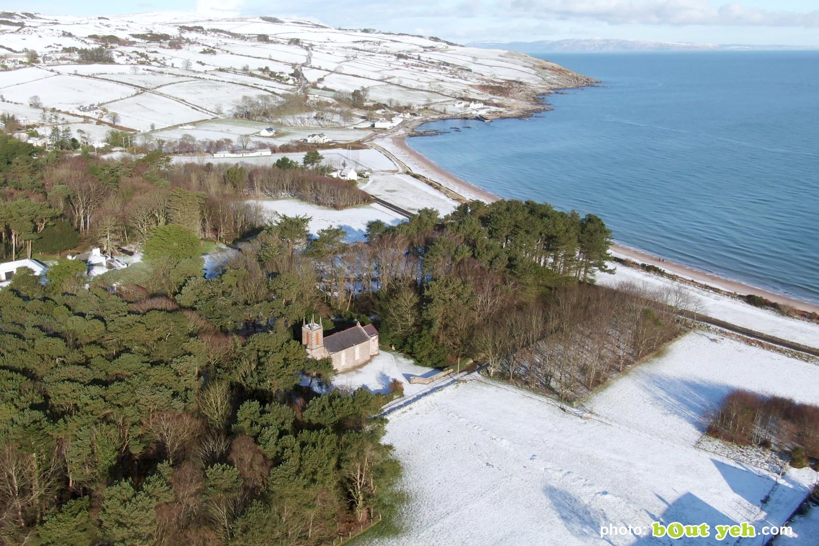 Aerial video of Cushendun under snow in winter by Bout Yeh photography and video production Belfast and Northern Ireland - video screenshot 2