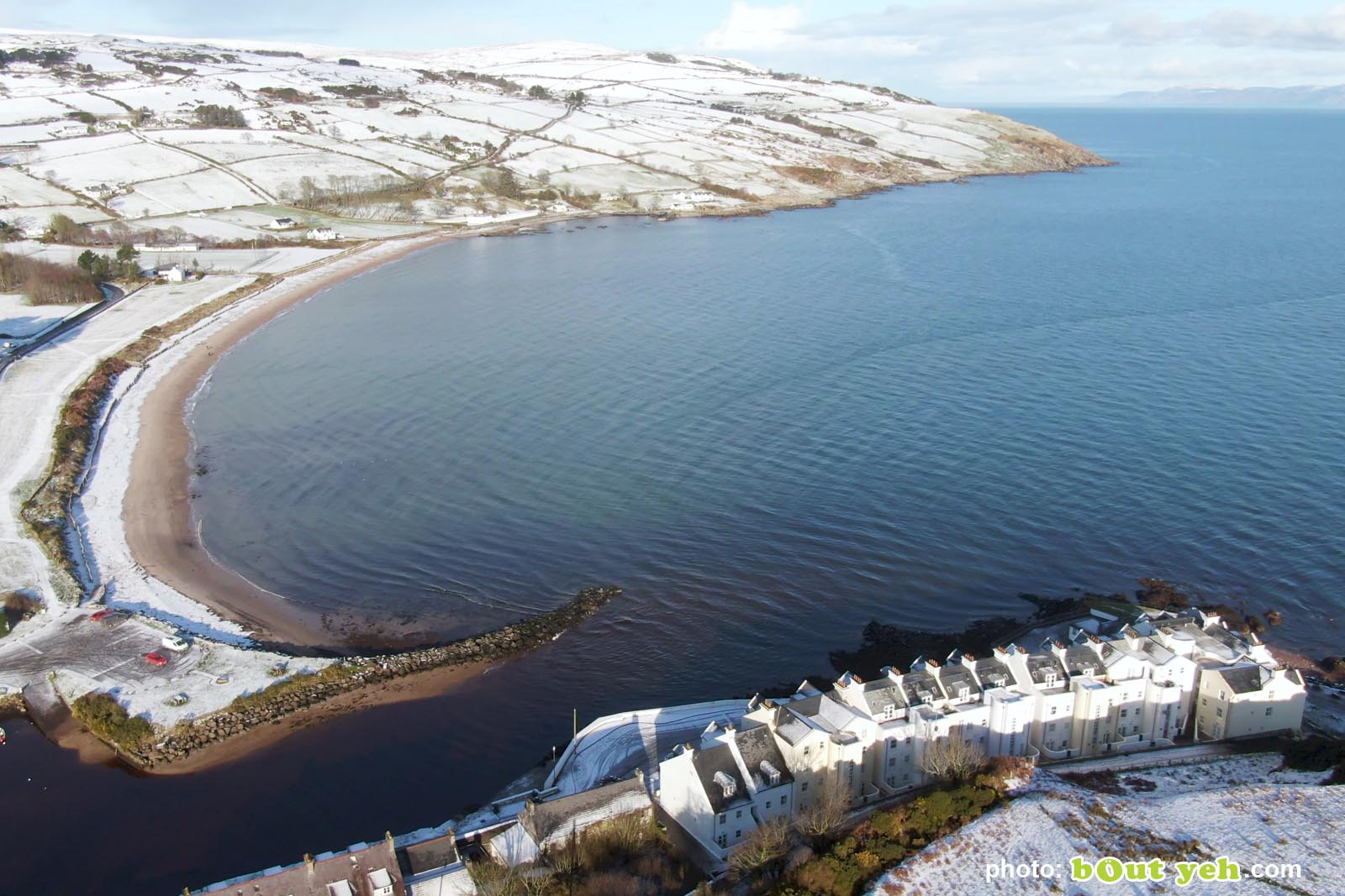 Aerial video of Cushendun under snow in winter by Bout Yeh photography and video production Belfast and Northern Ireland - video screenshot 4