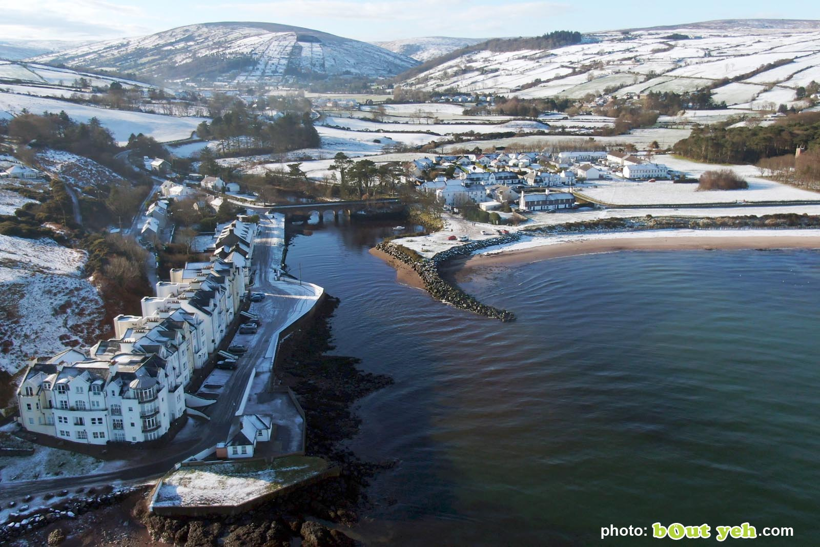 Aerial video of Cushendun under snow in winter by Bout Yeh photography and video production Belfast and Northern Ireland - video screenshot 5
