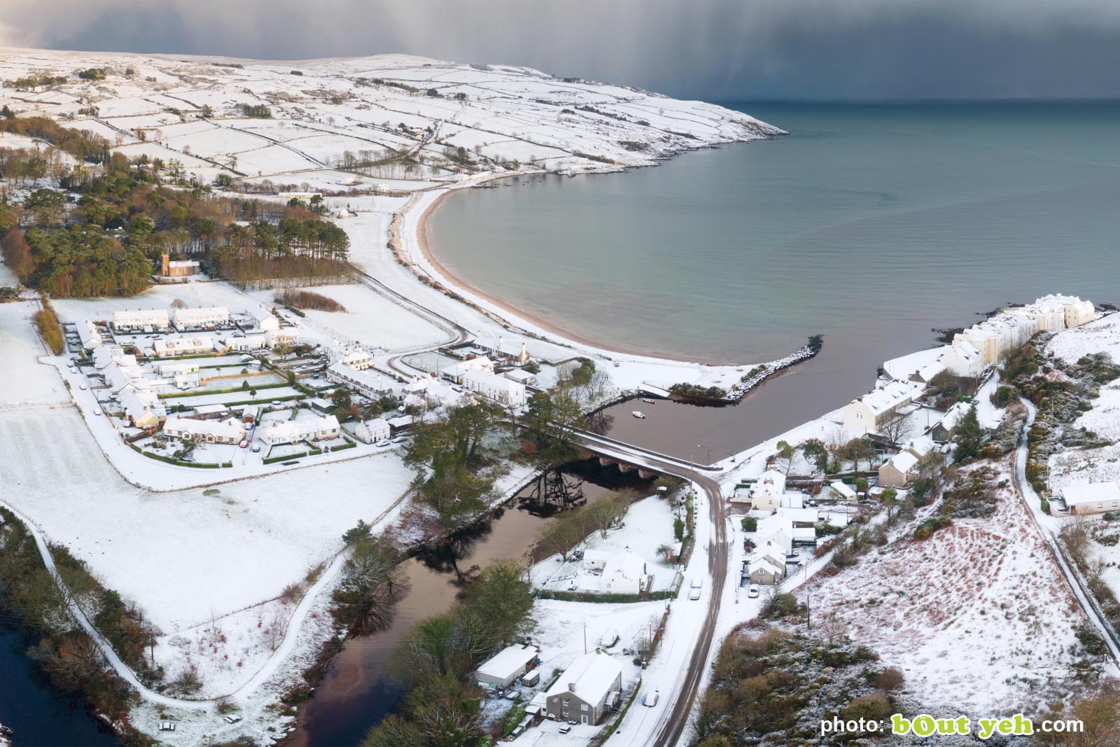 Aerial video of Cushendun under snow in winter by Bout Yeh photography and video production Belfast and Northern Ireland - video screenshot 6