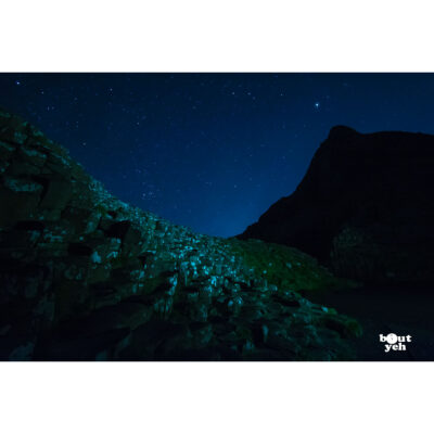 Photograph of Giants Causeway, Northern Ireland, under a star filled sky at night by Bout Yeh photographers Belfast. Photo 2764